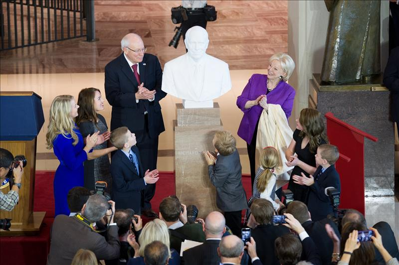 The extended family of former Vice President Dick Cheney surrounds the bust