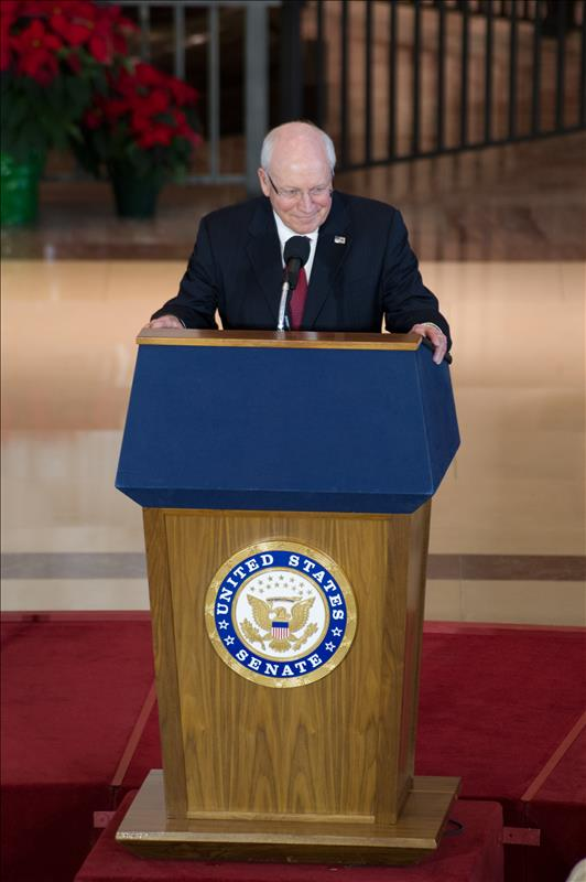 Former Vice President Dick Cheney standing behind a podium