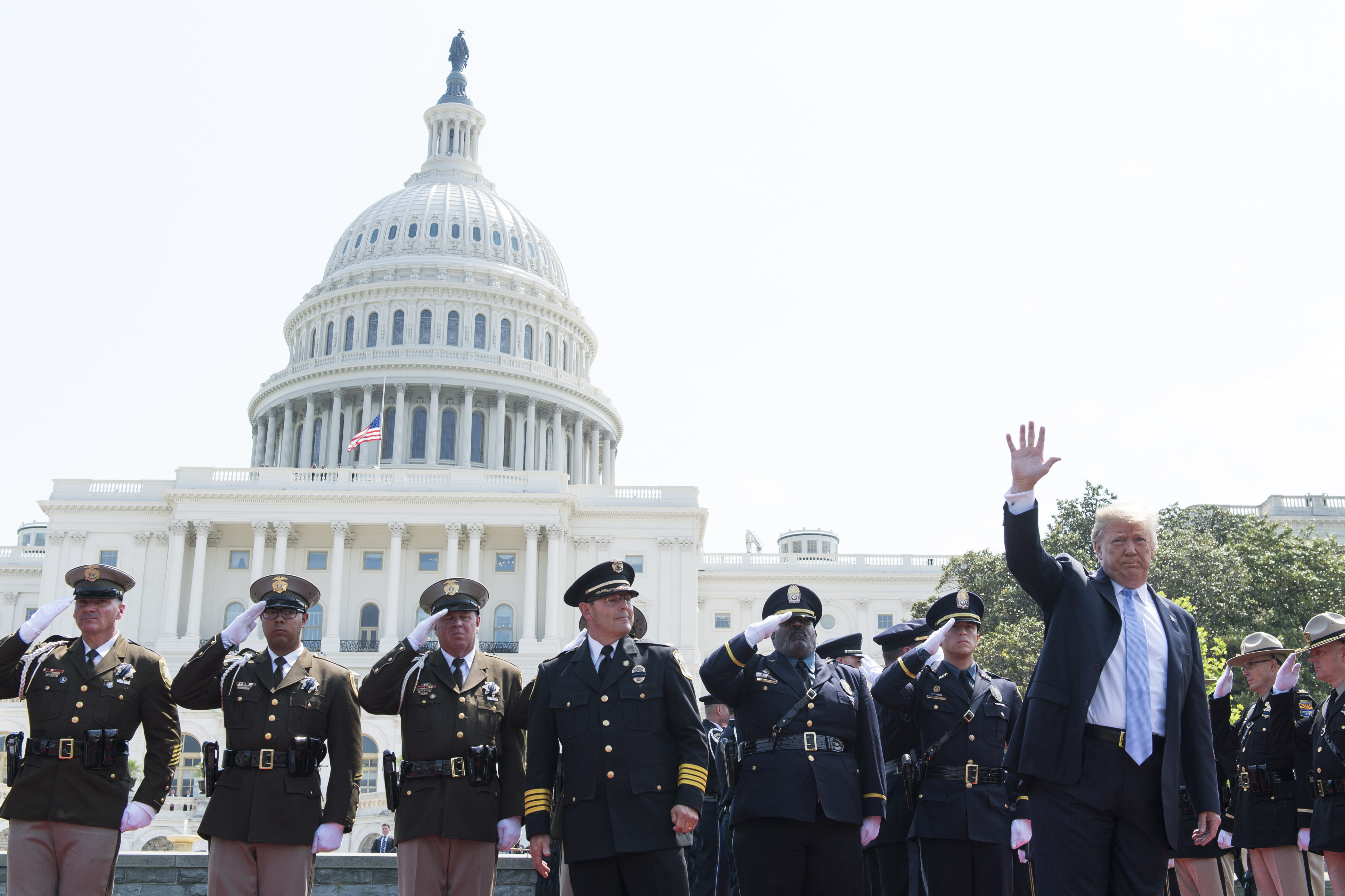 President Donald Trump and peace officers on the West Front of the U.S. Capitol