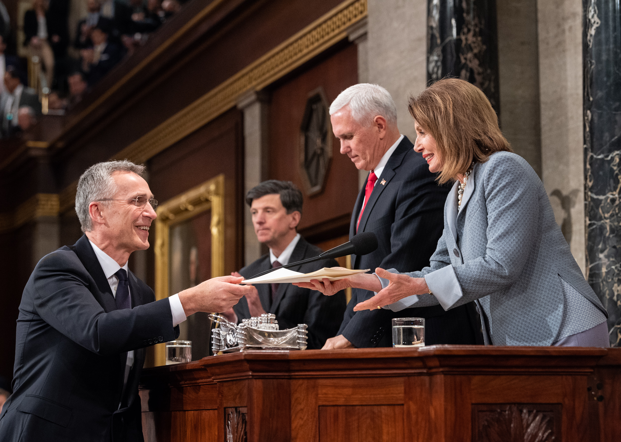 NATO Secretary General Jens Stoltenberg greets Nancy Pelosi and Mike Pence.