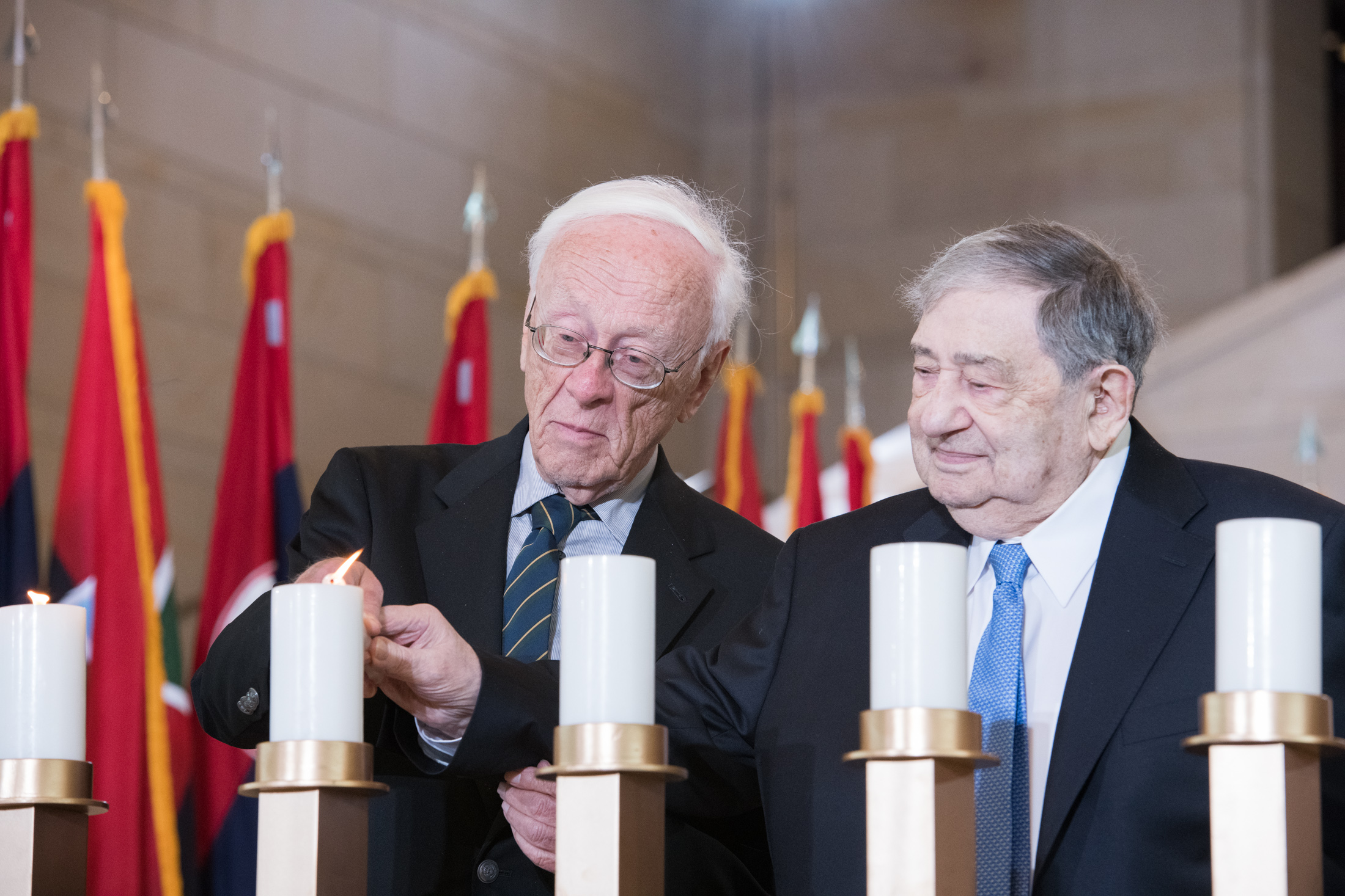 Holocaust survivors lit six remembrance candles during the ceremony. Photo by Kristie Boyd.