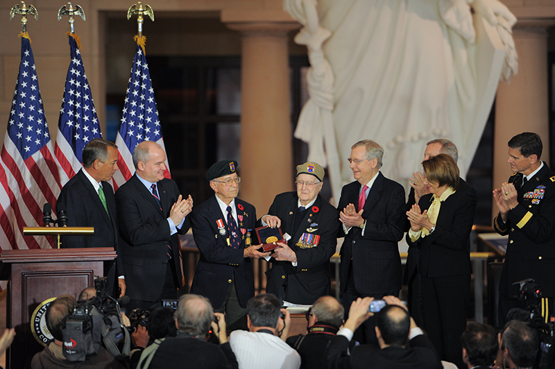 Congressional leaders present a medal to 1st Special Service Force veterans