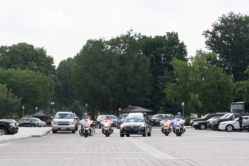 A hearse carrying the Senator McCain arrives at the U.S. Capitol. Photo by Phi Nguyen.