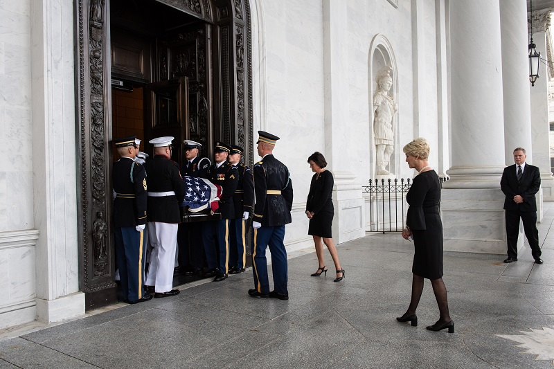 Senator McCain's wife Cindy follows his casket  into the U.S. Capitol. Photo by Dana Barciniak.