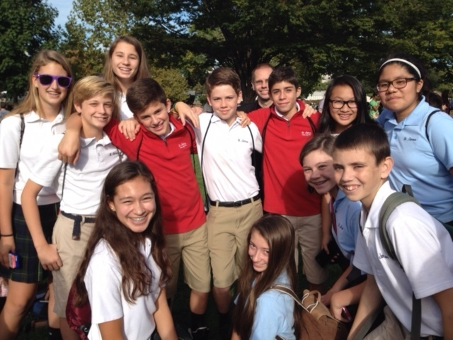 Students from St. James School in Falls Church, Va., await the Pope