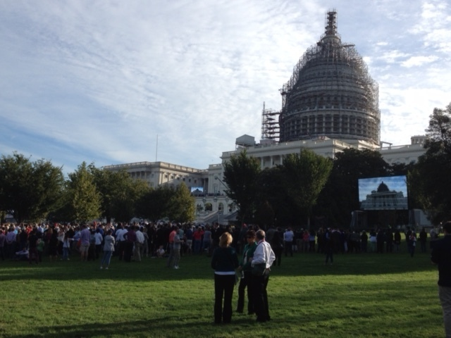 Screens were set up outside the Capitol so crowds could see the Pope's speech