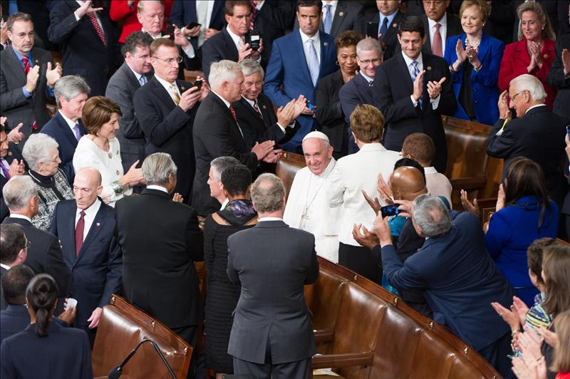 Pope Francis enters the House chamber