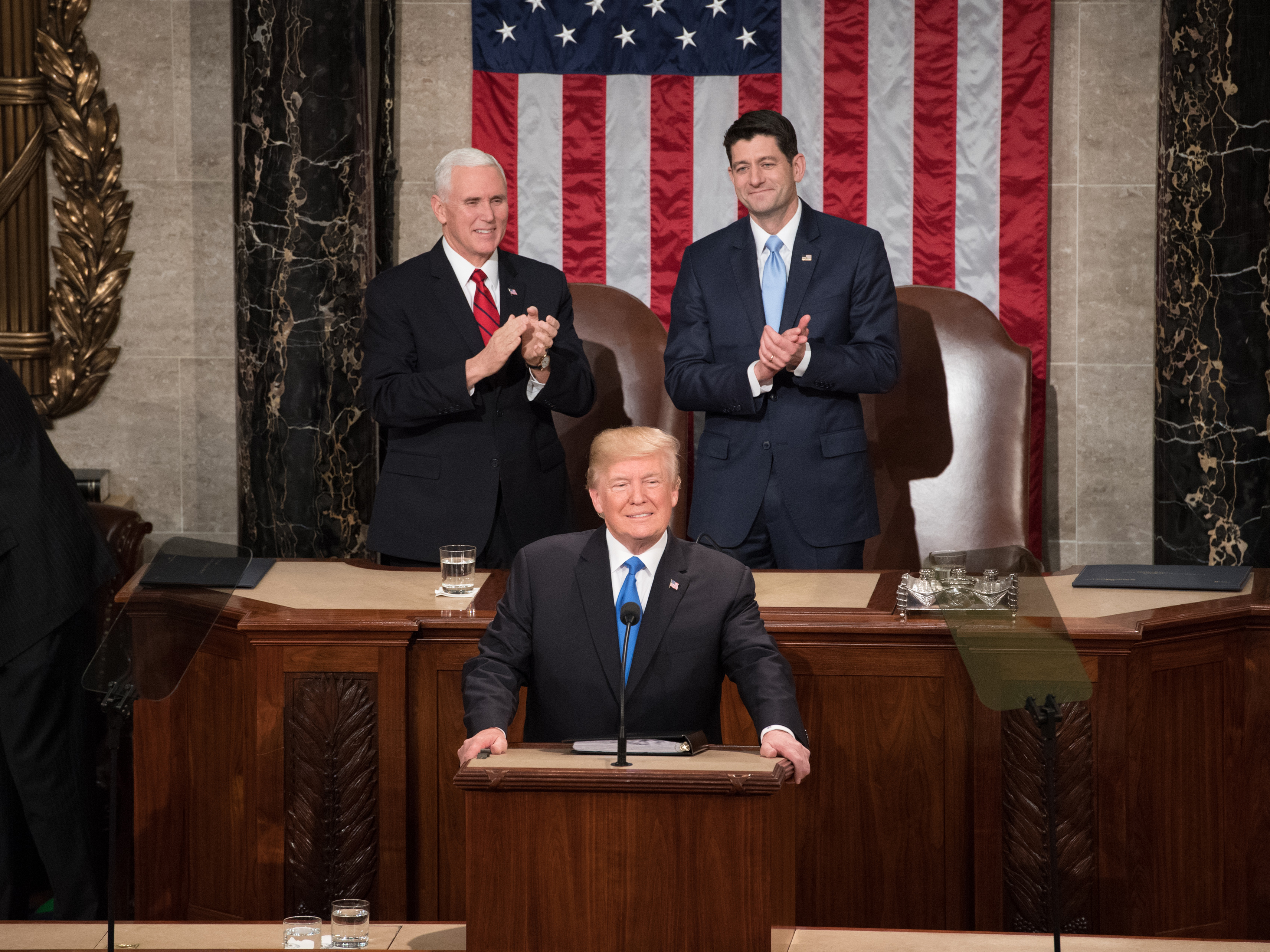 President Donald Trump flanked by Vice President Mike Pence and Speaker Paul Ryan