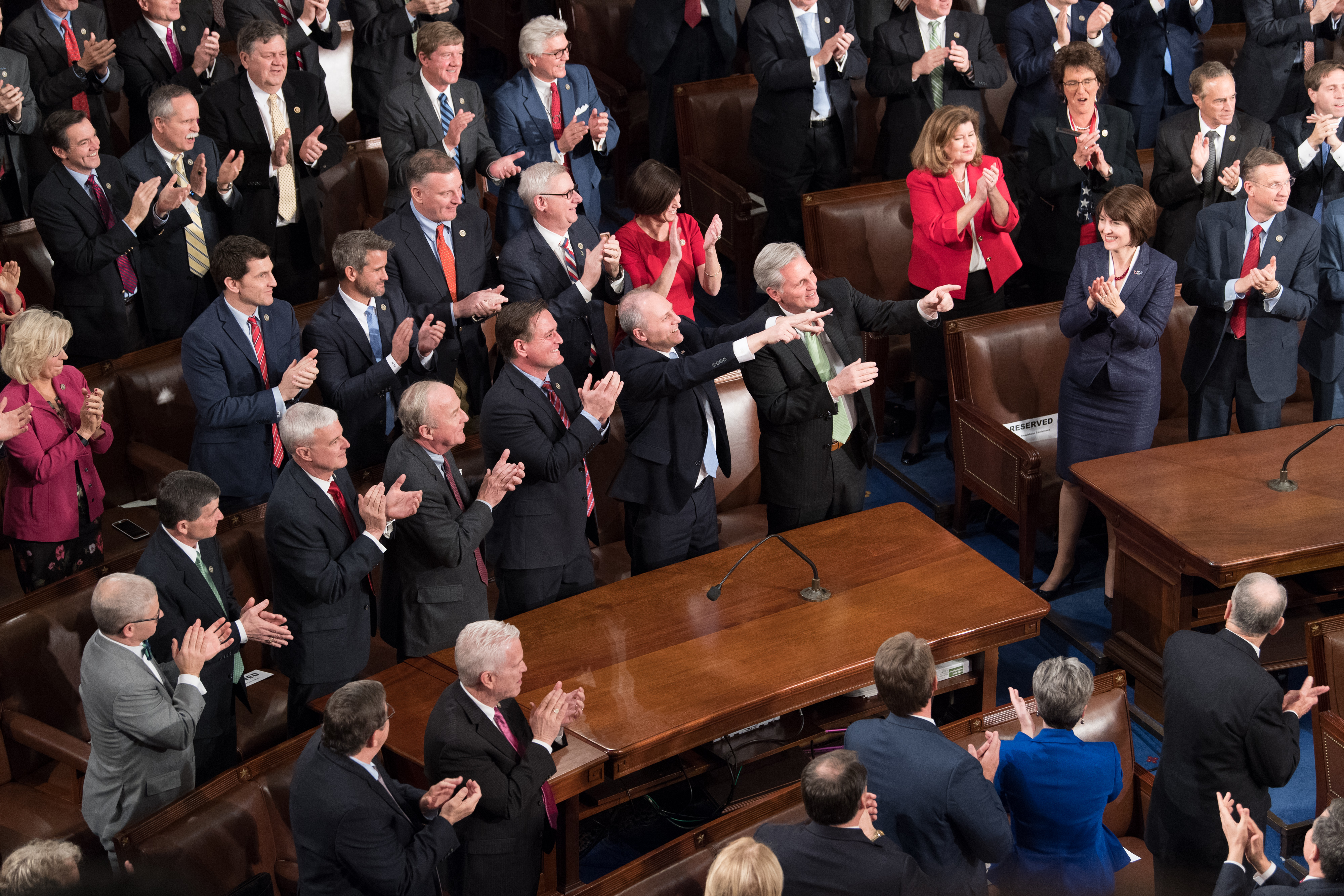 Majority Whip Steve Scalise points back at President Donald Trump during the State of the Union