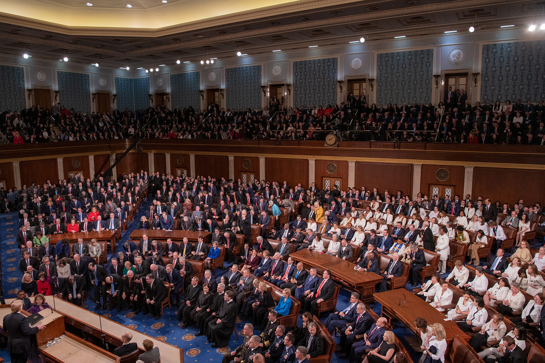 Members of Congress and inguished guests gathered to hear President Donald Trump
