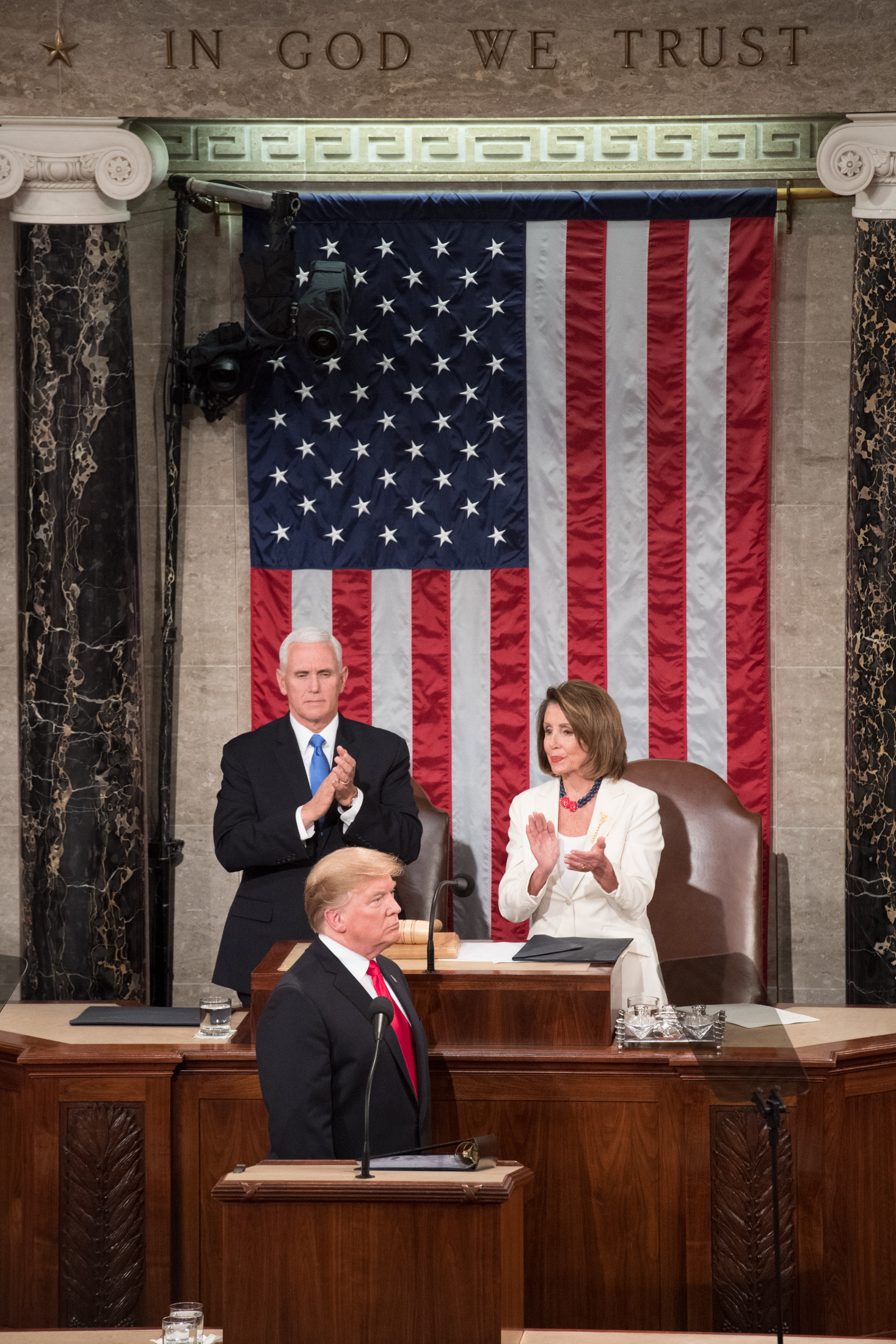President Donald Trump flanked by Vice President Mike Pence and Speaker Nancy Pelosi