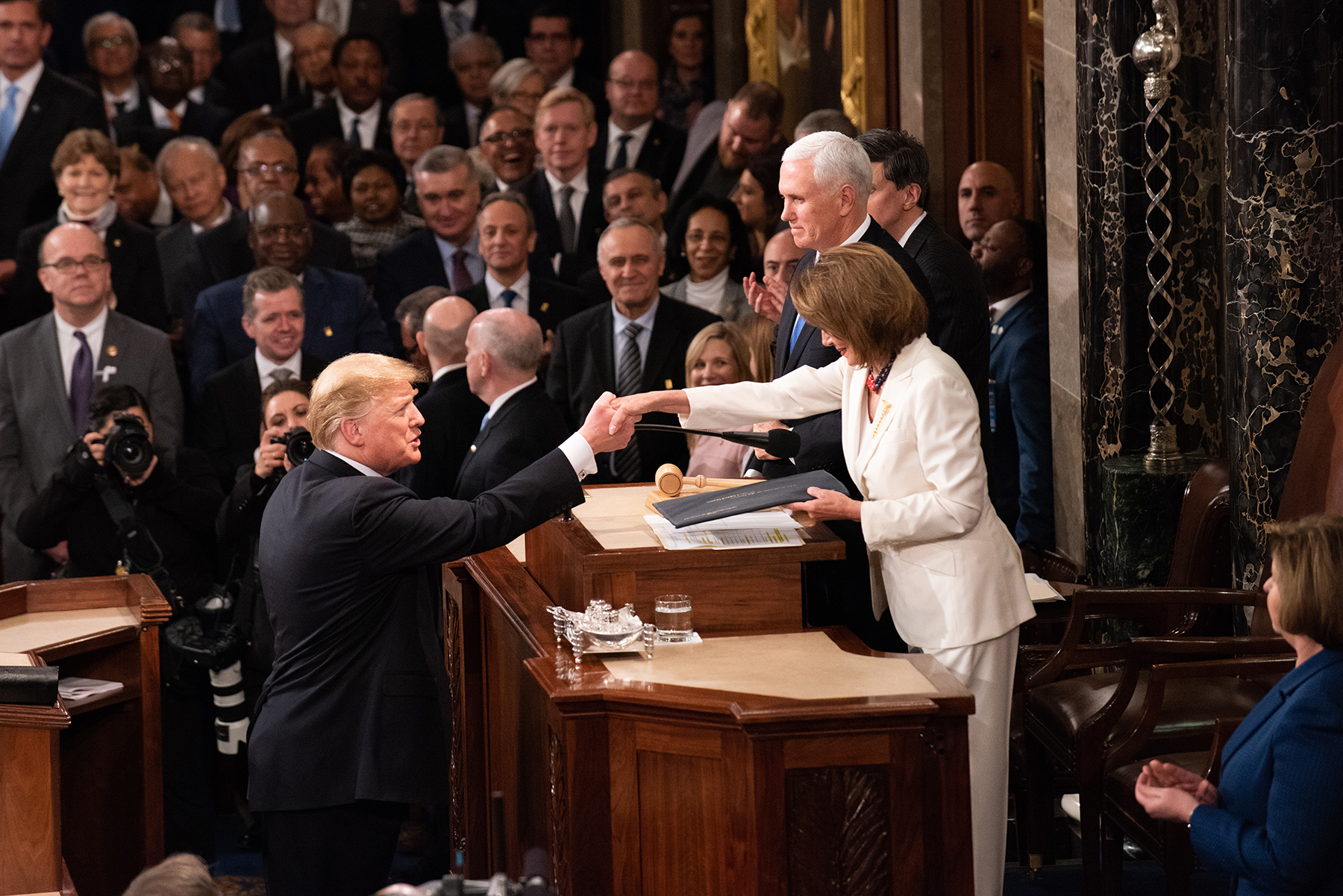 President Donald Trump shakes hands with U.S. House of Representatives Speaker Nancy Pelosi