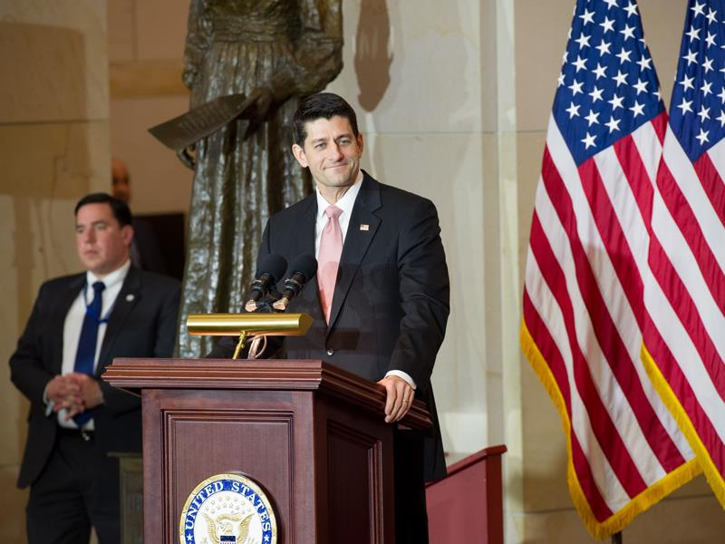 House Speaker Paul Ryan standing behind a podium next to the U.S. flag