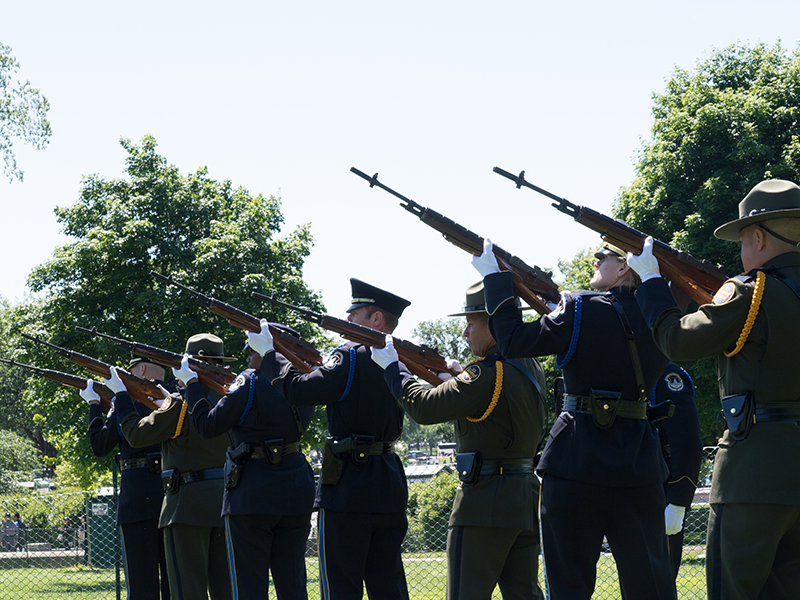 A twenty-one gun salute to the fallen officers